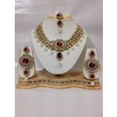 Amazing Kundan Jewelry Set In Maroon With Pearls