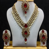 Dazzling Kundan Set In White & Red Stones And Pearls