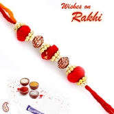 Red Cotton Balls And Golden Rings Mauli Rakhi