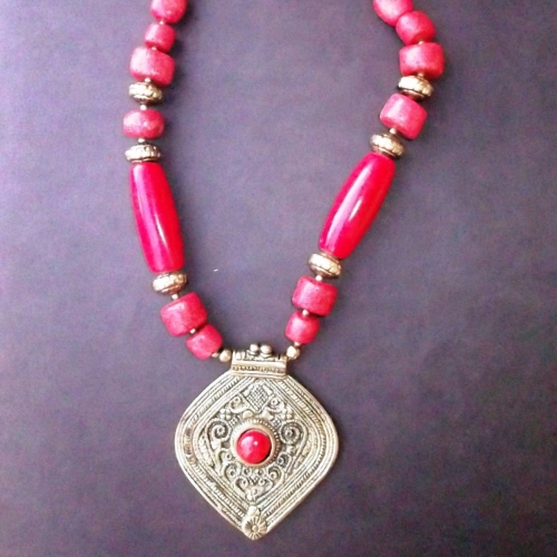 Hand-made Dhokra Pendant With Red Stones