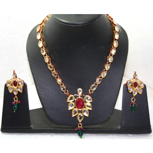 1 Gm Gold Platted Kundan Necklace Set Studded With Semi Precious Stones .